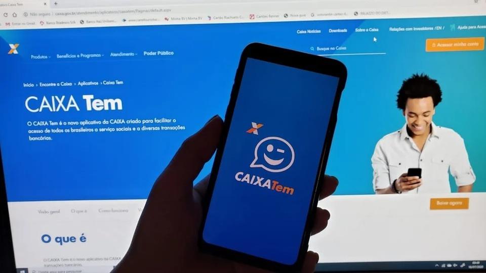 Caixa Tem: como mudar e-mail; smartphone aberto no Caixa Tem e Notebook no fundo