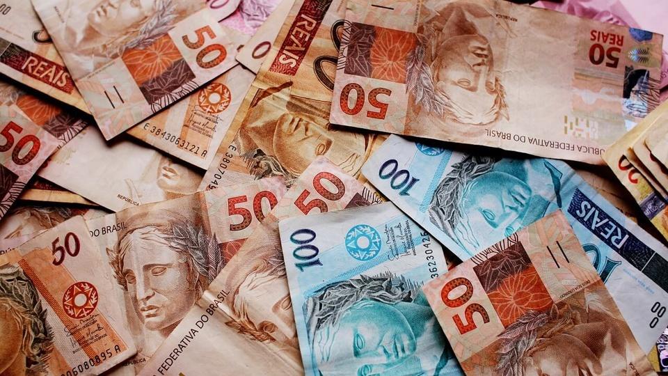 Caixa define novas datas de saques do auxílio emergencial: dinheiro